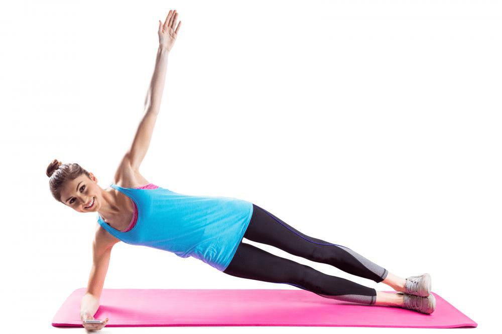 woman doing side plank