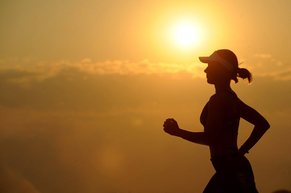 girl jogging during sunset