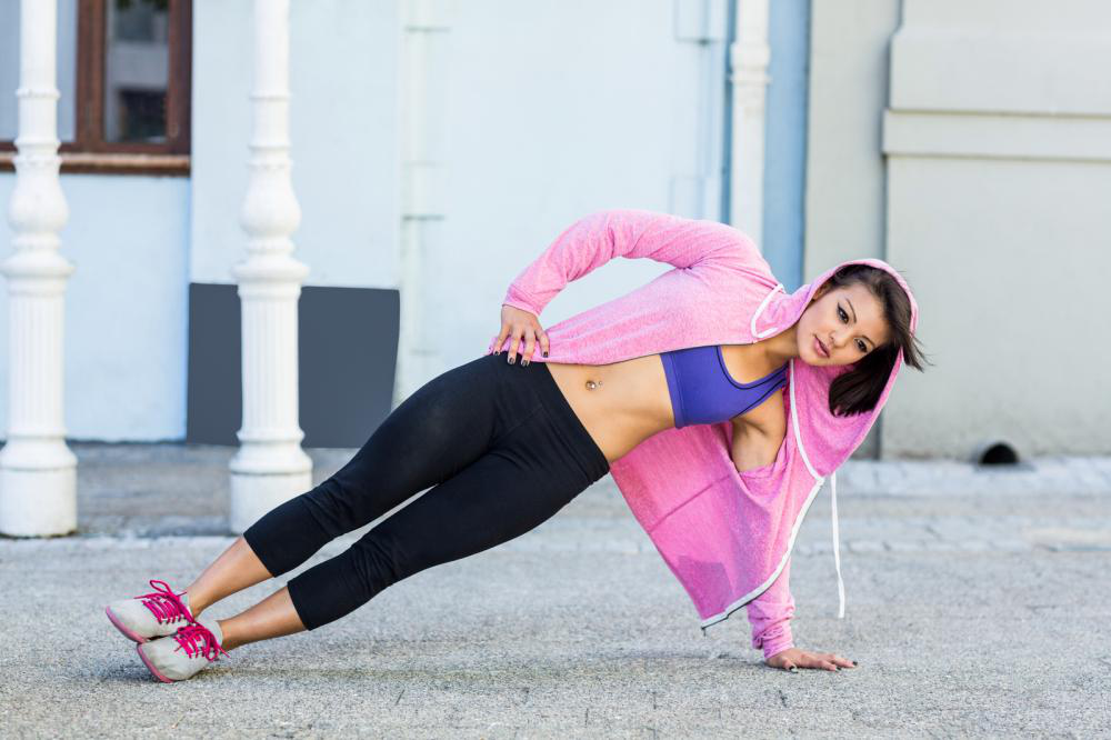 athletic woman excercising side plank